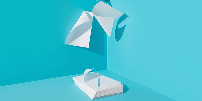 papers flying blue background