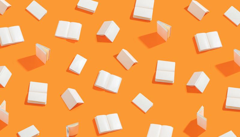 Books on orange background