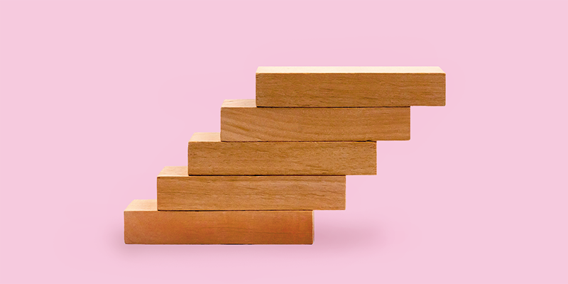 Wooden blocks on a pink background
